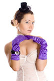 Attractive woman in corset, gloves and little hat Stock Image