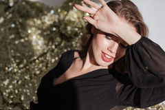 Attractive woman covered her face from bright light by hand Royalty Free Stock Photos