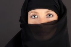Attractive woman covered by a veil Royalty Free Stock Image
