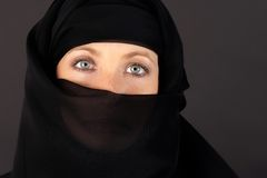 Attractive woman covered by a veil Royalty Free Stock Images