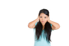 Attractive woman covering her ears i Royalty Free Stock Images