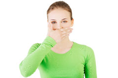 Attractive woman covering her mouth. Stock Images