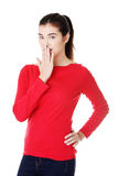 Attractive woman covering her mouth. Stock Photos