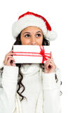 Attractive woman covering mouth with gift box Royalty Free Stock Images