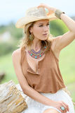 Attractive woman with cowboy hat and accessories Royalty Free Stock Photography