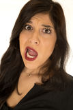 Attractive woman with crazy expression her large mouth open Stock Photography