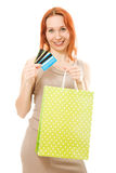 Attractive woman with credit cards and shopping. Attractive woman with cards and shopping isolated on white Royalty Free Stock Photography