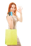 Attractive woman with credit cards and shopping Stock Photography