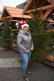 Attractive woman with cristmas hat on the christmas market Royalty Free Stock Photos