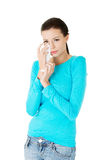 Attractive woman crying, holding a tissue. Stock Photography