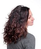 Attractive woman with curly hair Royalty Free Stock Image