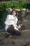 Attractive woman  with a dachshund dog on the mountain Stock Image