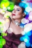 Attractive woman dancing in nightclub Stock Photos