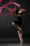 Attractive woman dancing with ribbon Royalty Free Stock Images