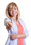 Attractive woman with dark eyes showing thumb up Royalty Free Stock Photography