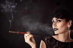 Attractive woman with dark makeup Royalty Free Stock Image