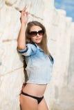 Attractive woman in denim jacket Stock Images