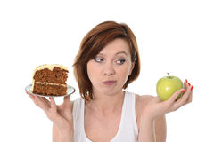 Attractive Woman Dessert Choice Junk Cake or Apple Royalty Free Stock Images