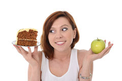 Attractive Woman Dessert Choice Junk Cake or Apple Royalty Free Stock Photos