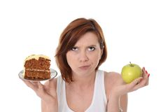 Attractive Woman Dessert Choice Junk Cake or Apple Royalty Free Stock Image