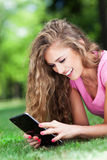 Attractive woman with digital tablet Stock Images