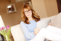 Attractive woman with digital tablet Royalty Free Stock Photography