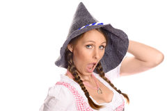 Attractive woman in a dirndl and party hat Royalty Free Stock Images