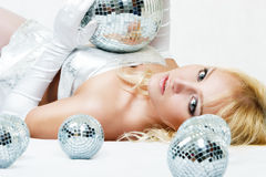 Attractive woman with disco ball Stock Images