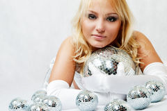 Attractive woman with disco ball Royalty Free Stock Images