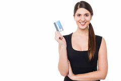 Attractive woman displaying her credit card Stock Photo