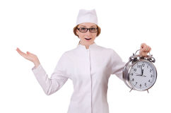 Attractive woman doctor with big clock Royalty Free Stock Photos