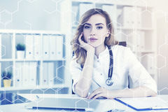 Attractive woman doctor in her office, toned Stock Images