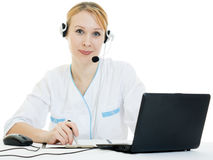 Attractive woman doctor operator Royalty Free Stock Images