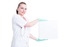 Attractive woman doctor smiling with a box on her hands Royalty Free Stock Images