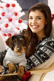 Attractive woman with dog at xmas Royalty Free Stock Image