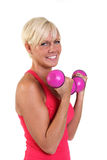 Attractive woman doing bicep curls Stock Photo