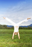 Attractive woman doing cartwheel Royalty Free Stock Photos