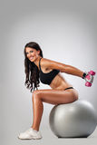 Attractive woman doing exercise Stock Photo