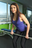 Attractive woman doing exercise with weight bar Royalty Free Stock Photography