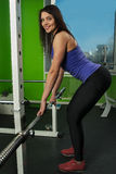Attractive woman doing exercise with weight bar Stock Photography