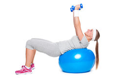 Attractive woman doing exercises Royalty Free Stock Image