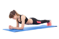 Attractive woman doing exercises for abdominal muscles isolated Stock Photo