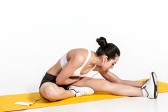 Attractive woman doing exercises. Brunette fit body on yoga mat Royalty Free Stock Photo