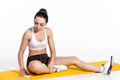 Attractive woman doing exercises. Brunette fit body on yoga mat Royalty Free Stock Photos