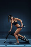 Attractive woman doing exercises for the triceps Royalty Free Stock Image