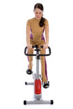 Attractive woman doing fitness on a bike Royalty Free Stock Photography