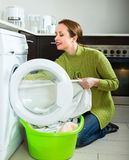 Attractive woman doing laundry Stock Image