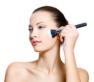 Attractive  woman doing make-up Stock Images