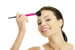 Attractive woman doing make-up on face. Stock Photo