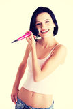 Attractive woman doing make-up on face. Royalty Free Stock Photography